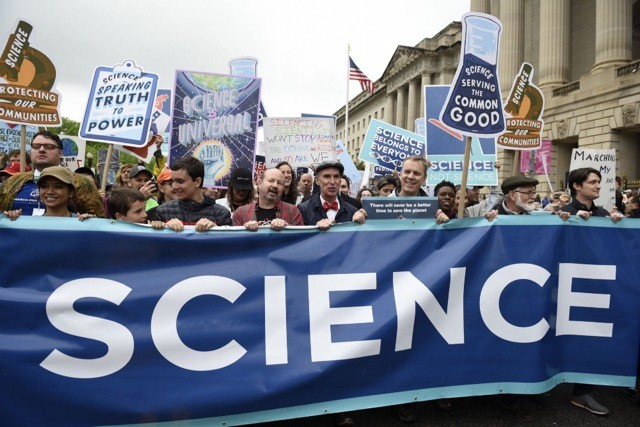 Michael Mann, distinguished professor of atmospheric science at Penn State, and Bill Nye, a prominent science communicator, lead the March for Science last month in Washington, D.C.